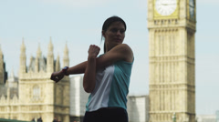 MS Woman stretching, Palace of Westminster in background / London, UK Stock Footage