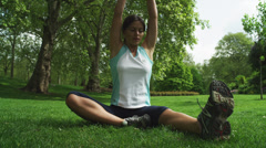 MS Woman stretching on grass in St. James Park / London, UK Stock Footage