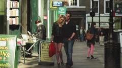 WS Young couple walking on sidewalk / London, UK Stock Footage