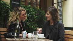 MS Two women talking at outdoors cafe / London, UK Stock Footage