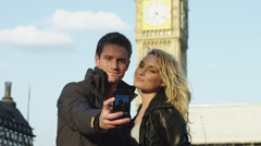 MS Couple taking self photo in front of Big Ben / London, UK Stock Footage