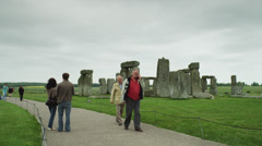 T/L WS Stonehenge monument and tourists / Wiltshire, UK Stock Footage