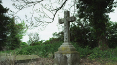 WS Cross on old tombstone / Bradford on Avon, Wiltshire, UK Stock Footage