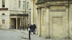 WS Senior couple walking down street / Bath,Somerset, UK Stock Footage
