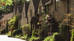 WS Row of stone houses / Castle Combe, Cotswolds, Wiltshire, UK - stock footage