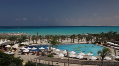 Pool and turquoise sea in a resort in Marsa Matruh, Egypt Stock Footage