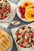 Healthy whole wheat shredded cereal Stock Photos