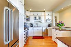 Stock Photo of bright light tones kitchen interior.