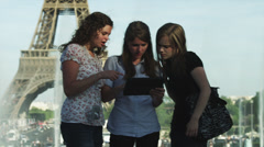 MS Young women reading guidebook in front of Eiffel Tower / Paris, France Stock Footage