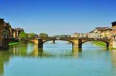 Arno river and ponte santa trinita bridge in florence, italy Stock Photos