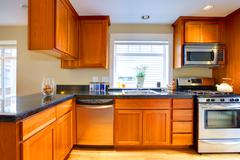 Stock Photo of modern cherry wood kitchen in a city apartment