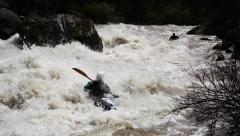 Kayakers descend big whitewater Stock Footage