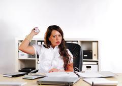 secretary with creased paper - stock photo