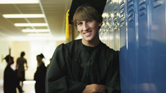 MS DS Portrait of male graduate in school corridor / Spanish Fork City, Utah, Stock Footage