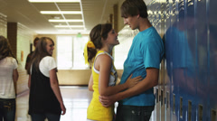 MS Teenage couple (14-17) embracing in school corridor / Spanish Fork City, Stock Footage