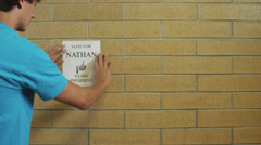 MS ZO Students attaching posters on wall / Spanish Fork City, Utah, USA Stock Footage