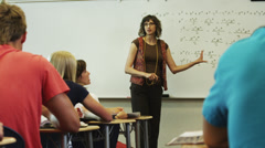 MS DS Teacher talking to students during classes / Spanish Fork City, Utah, USA Stock Footage