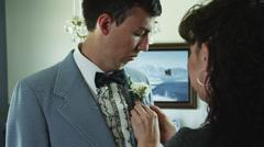 MS Mother adjusting son's tuxedo / Provo, Utah, USA - stock footage