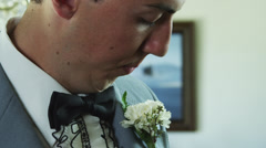 CU Mother adjusting son's tuxedo / Provo, Utah, USA Stock Footage