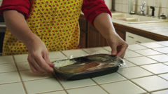 MS TU Woman opening tv dinner in kitchen / Provo, Utah, USA Stock Footage