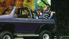 MS PAN Kids (4-11) riding bumper cars in amusement park / American Fork City, Stock Footage