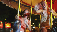 MS POV Girls (16-17) riding carousel in amusement park / American Fork City, Stock Footage