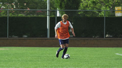 MS PAN Player dribbling ball across soccer  field / Provo, Utah, USA Stock Footage