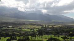 Clouds over green mountain slopes in Kaanapali Stock Footage