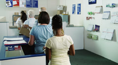 MS People waiting in line at post office / Orem, Utah, USA Stock Footage
