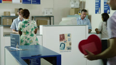 MS Man packing heart chocolate box into cardboard box at post office / Orem, Stock Footage