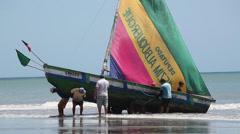 Brazilian Fishermen pulling boat ashore 2 Stock Footage