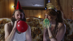 MS Couple having party in living room at Christmas/ Orem, Utah, USA Stock Footage