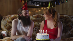 MS TD Couple celebrating mans birthday in living room, man smoking cigarette/ Stock Footage