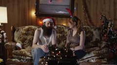 MS PAN Man giving woman Christmas present on living room sofa/ Orem, Utah, USA Stock Footage