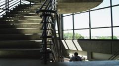 WS TU Man running up office stairs / Orem, Utah, USA Stock Footage