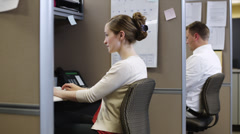 MS ZI Woman using computer in office / Orem, Utah, USA Stock Footage