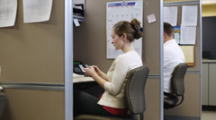 MS ZI Woman texting at desk in office / Orem, Utah, USA Stock Footage