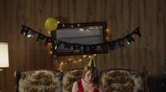 MS TD Young woman with birthday cake, on living room sofa/ Orem, Utah, USA Stock Footage