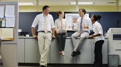 WS ZI Four office workers talking / Orem, Utah, USA Stock Footage