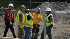 Construction crew discussing work 1 - stock footage
