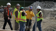 Stock Video Footage of Construction crew discussing work 1
