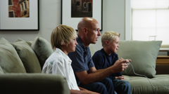 ZI MS Father with two sons (8-9, 10-11) playing video game / Orem, Utah, USA - stock footage