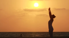 Silhouette of a beautiful Yoga woman Stock Footage
