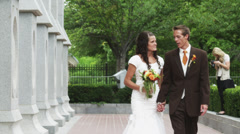 MS DS Bride and groom walking and kissing in garden / Salt Lake City, Utah, USA - stock footage