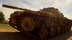 Desert Camo Army Tank Front Side View Low Angle- Barstow CA - stock footage