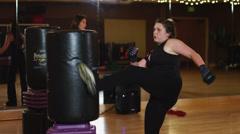 MS Women practicing kick boxing in gym / Draper, Utah, USA Stock Footage