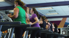 CU DS People exercising on elliptical machine in gym, low section / Draper, - stock footage