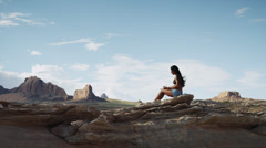 WS DS Young woman relaxing on rocks near Lake Powell / Utah, USA Stock Footage
