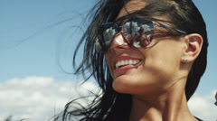 CU Young woman wearing sunglasses laughing / Lake Powell, Utah, USA Stock Footage
