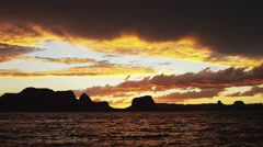 SLO MO WS Silhouette of two young women wading in Lake Powell at sunset / Utah, Stock Footage